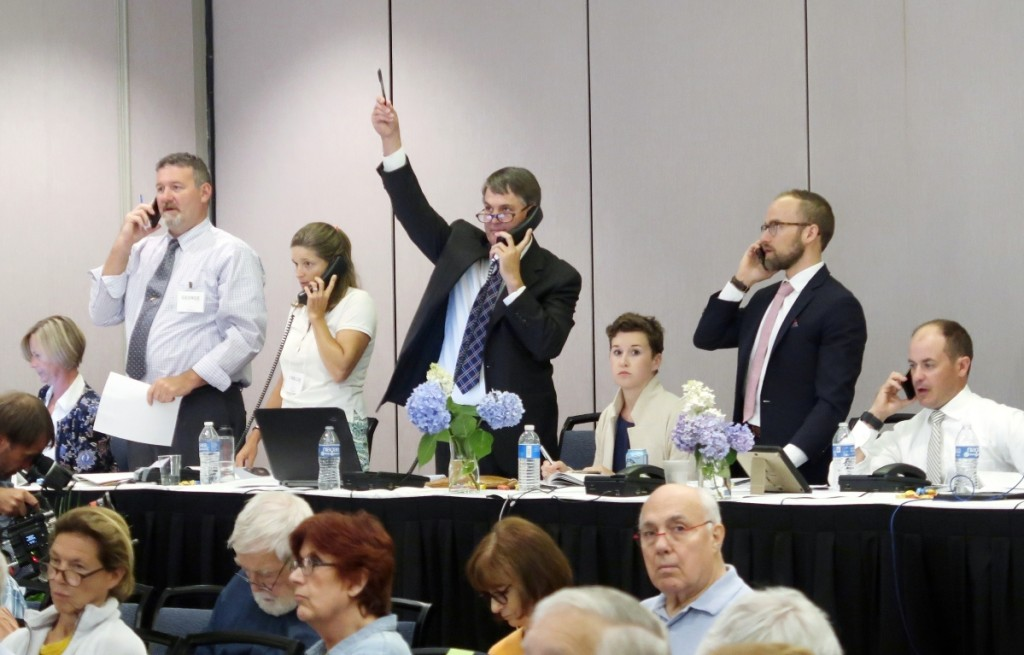 Seasoned bidders participated by phone on the top lots. Here, Copley chief executive officer Stephen O'Brien Jr hoists his paddle against competition from, standing from left, George Foster, Chelsie Olney and decoy specialist Colin McNair.