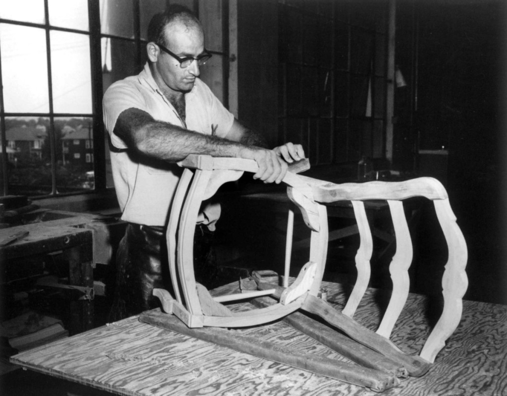A craftsman in Kaplan's workshop sands a Chippendale-style ribbon-back chair (also called a ladder-back chair with pierced rails), Cambridge, Mass., 1924. Courtesy, Joseph Downs Collection of Manuscripts and Printed Ephemera, Henry Francis du Pont Winterthur Museum.