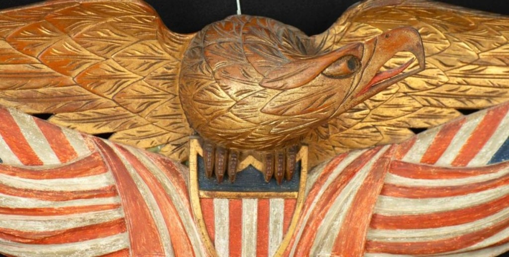 The highest priced item in the sale was this gilded Bellamy eagle, with a 25-inch wingspan, carved above a shield with two American flags. It sold to a phone bidder for $42,000. At one time, the flags had been painted over but that paint was removed to show the original colors.