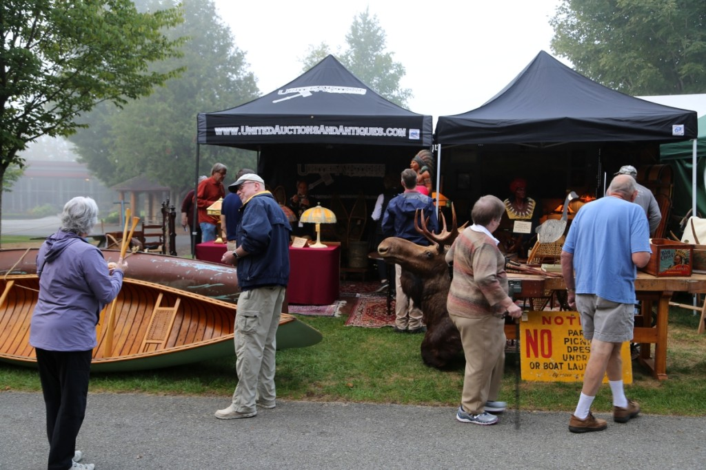 Buyers were flocking around the booth of United Auctions, Olean, N.Y.