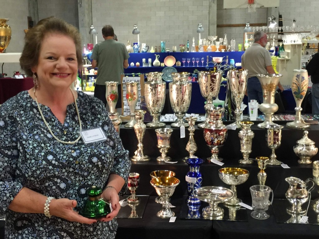 Diantiques, Diane Lytwyn, from Southport, Conn., brought her collection of mercury, Bohemian, American cut and engraved glass. She is seen here holding a signed Lunt inkwell.