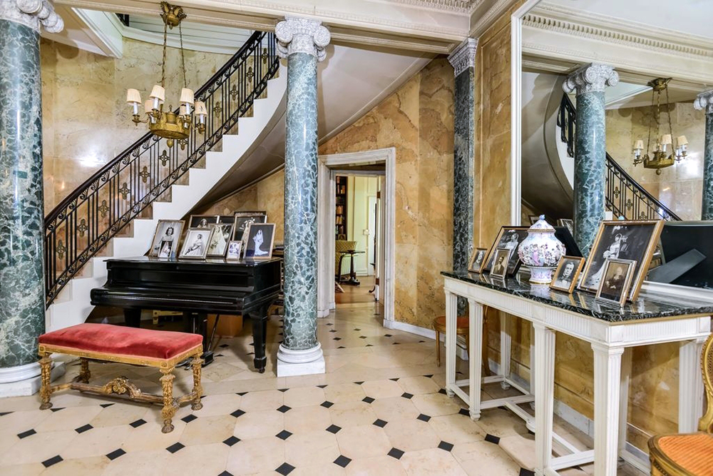In the foyer, a Steinway and Sons baby-grand piano, $4,200. The Adam-style table at right, said to be a Codman choice, drew $3,600. Photo courtesy Sotheby's International Realty.