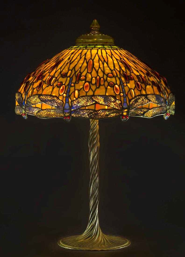 The top lot of the auction was this Tiffany Studios (N.Y.) drop head Dragonfly lamp, circa 1910, having a verdigris patinated leaded glass shade with jewel cabochons sold at $200,000.