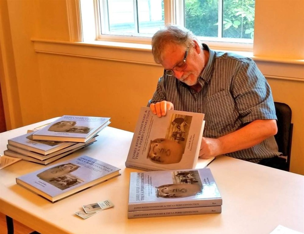 Curtis Rice signs copies of his new book James River Stoneware and the S. S. Perry Connection.
