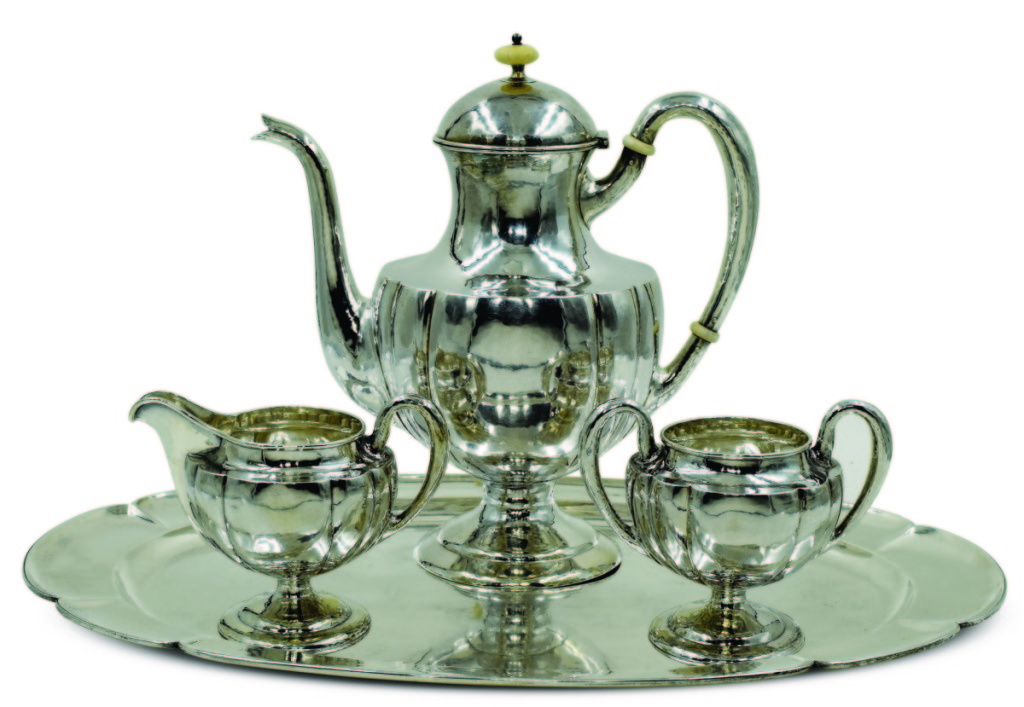 Tea set designed by Clara Barck Welles (1868–1965) and presented to Harry Logan Monroe, manufactured by the Kalo Shop, Chicago, 1928. Sterling silver; teapot height 11 inches. Collection of Melissa Monroe Dockum.