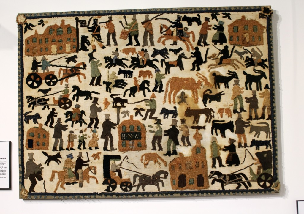 One of the eye-catching works at the show was this appliqued mat in the booth of Newsom & Berdan Antiques & Folk Art. The Thomasville, Penn., dealers said it had been deaccessioned from a military museum and discovered in New Hampshire. In untouched as-found condition, it depicted a colorful New England town celebration.