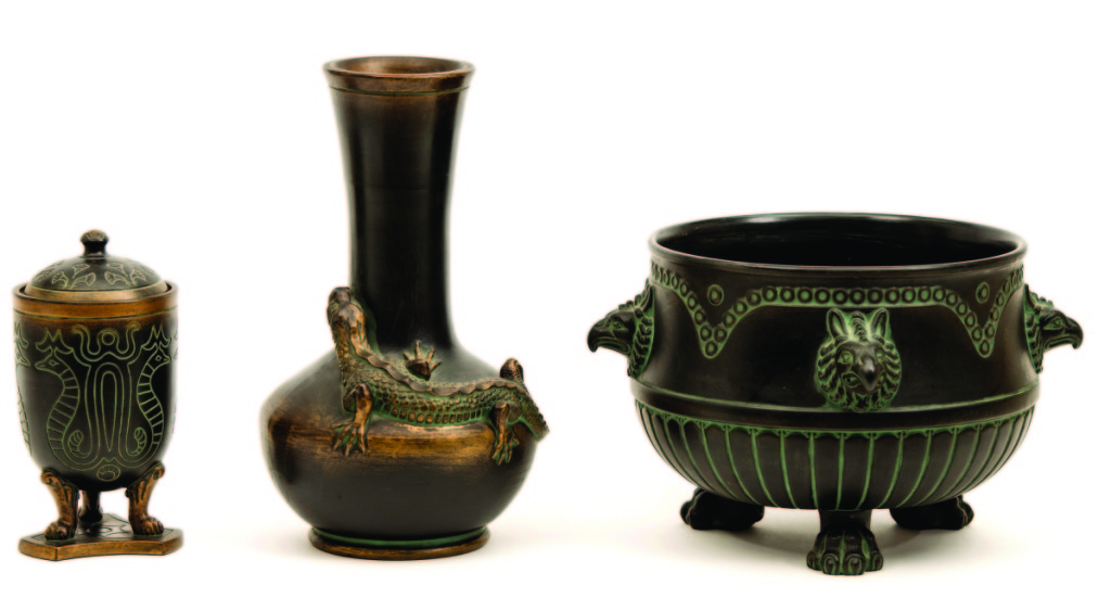 From left, a covered urn, lizard vase and jardinière manufactured by Norse Pottery Company, Rockford, Ill., 1903–12. Glazed earthenware; vase height 12¼ inches. Collection of John Danis.