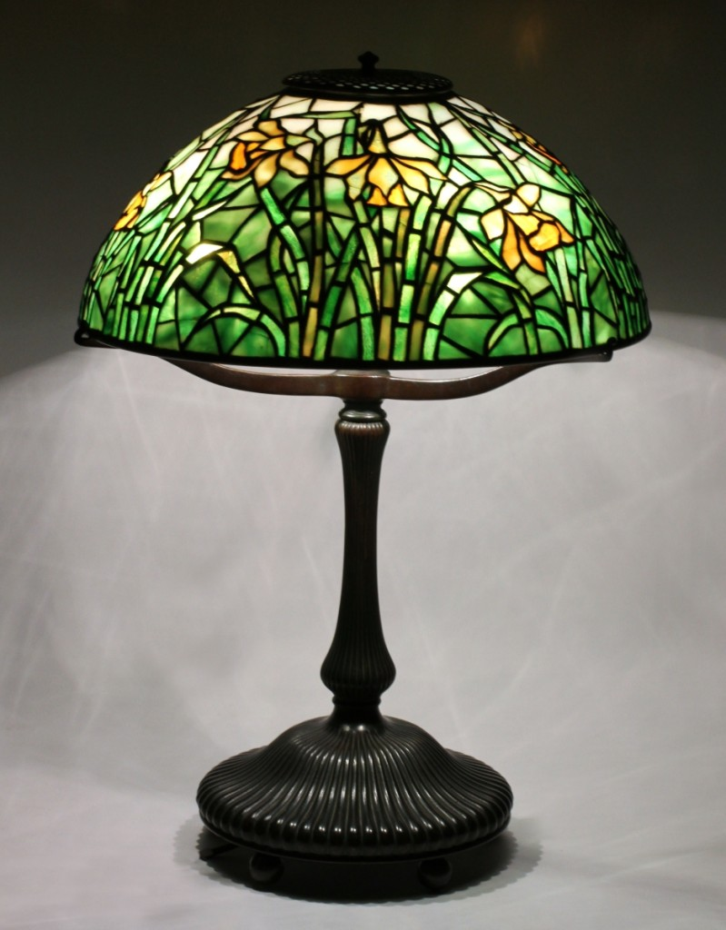 "Following closely behind the top lot was this Tiffany Studios New York leaded glass ""long-stemmed daffodil"" 18-inch- tall table lamp. It closed within estimate, at $31,000."