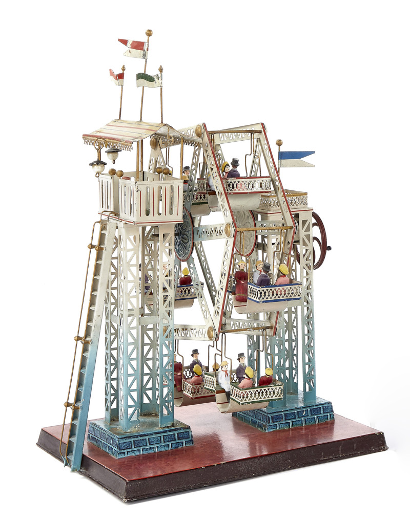 The Morton A. Hirschberg collection of steam toys, 121 lots, did well and was highlighted by Lot 401, Doll & Cie painted tin Ferris wheel steam toy with composition figures, largest of the Ferris wheels with six seats each with four riders. It measures 17 inches high, 13½ inches wide and 11 inches deep. The phone bidders were very active on this lot, one winning with a bid of $21,960. It carried a high estimate of $11,000.