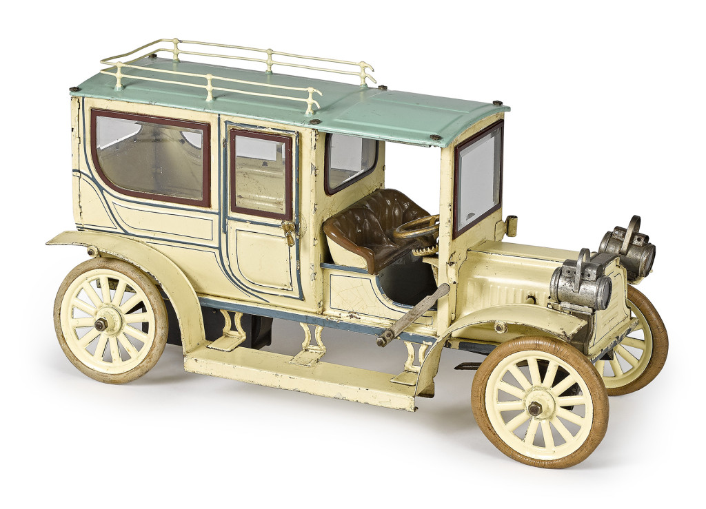 Selling for $14,640 was Lot 529, a large Carette tinplate clockwork limousine with a cream and teal blue surface, faux upholstered seat, beveled glass windows and roof rack. It measures 16 inches long and sold for $14,640, over the $12,000 high estimate.