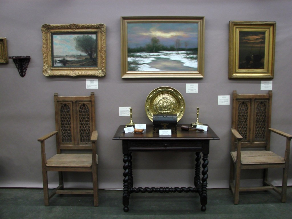 Jan and John Maggs, Conway, Mass., had a selection of early English oak furniture and paintings. The circa 1670 one-drawer table with a two-board top was priced at $975, and the late Eighteenth Century harbor scene by Dutch painter R. Van Son was priced $1,150.