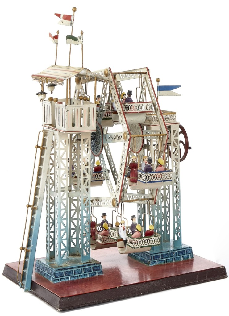 This Doll & Cie painted Ferris wheel steam toy #729/5, with composition figures, is the largest of the Ferris wheels with six seats, each with four riders. It measures 17 inches high, 13½ inches wide and 11 inches deep. It is in overall excellent condition and the web and phone battled it out for this lot. The phone bidder finally won, paying $21,960 for the Ferris wheel, close to twice the high estimate.