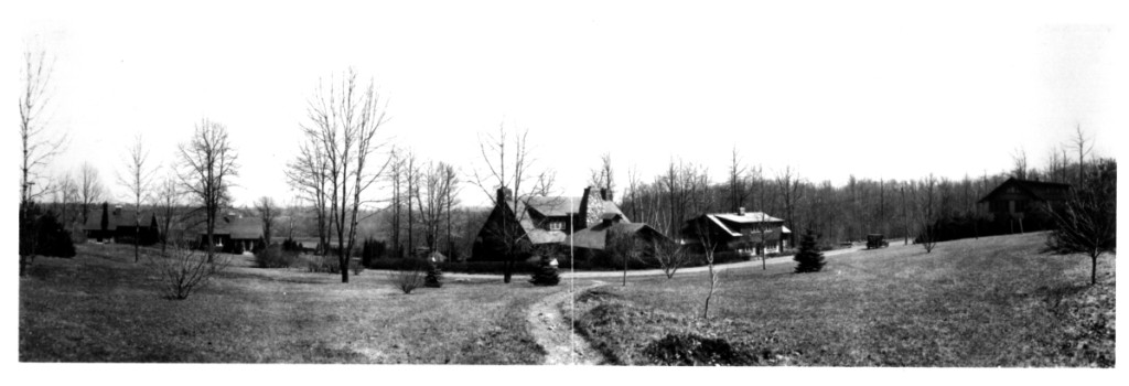Craftsman Farms complex circa 1920s with the garage building in view at the far right. No known Stickley-era photos exist. The entrance to the property, during this era, was down a winding driveway that ran southeast of the log house. The log house and driveway are visible in the center of the photo. The entrance was later moved across from the west side of the garage building, making it that building the de facto entrance to the property.