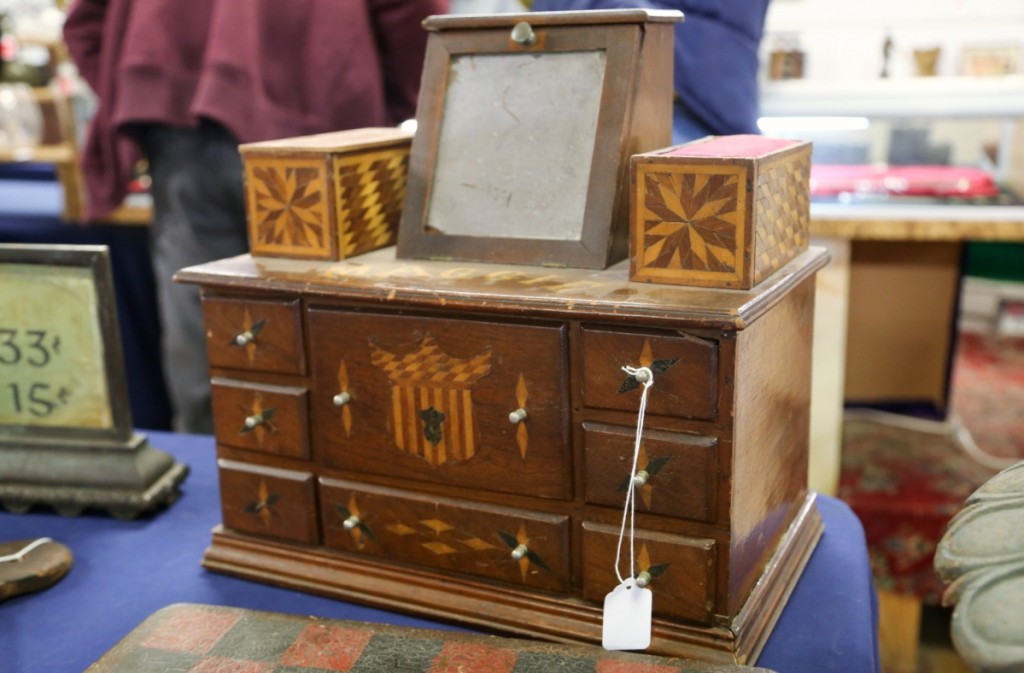 This nice little marquetry sewing box, complete with mirror and its original drawers, brought $604.