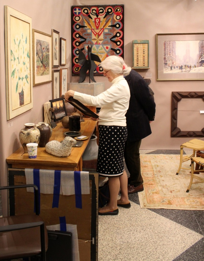 Customers browse the offerings by Garvey Rita Art & Antiques, Orleans, Mass.