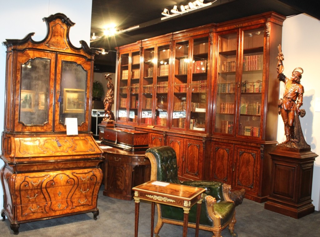 One of the highlights Butchoff Antiques, London, brought to the show was this circa 1825 eight-door mahogany library bookcase attributed to Gillows. A music box, numbered 20482, by B.A. Bremond of Geneva sits on the pedestal desk in front of the bookcase.