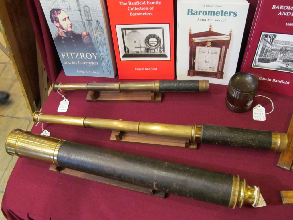 Barometer Fair offered a variety of antique telescopes, both handheld and with elaborate stands.