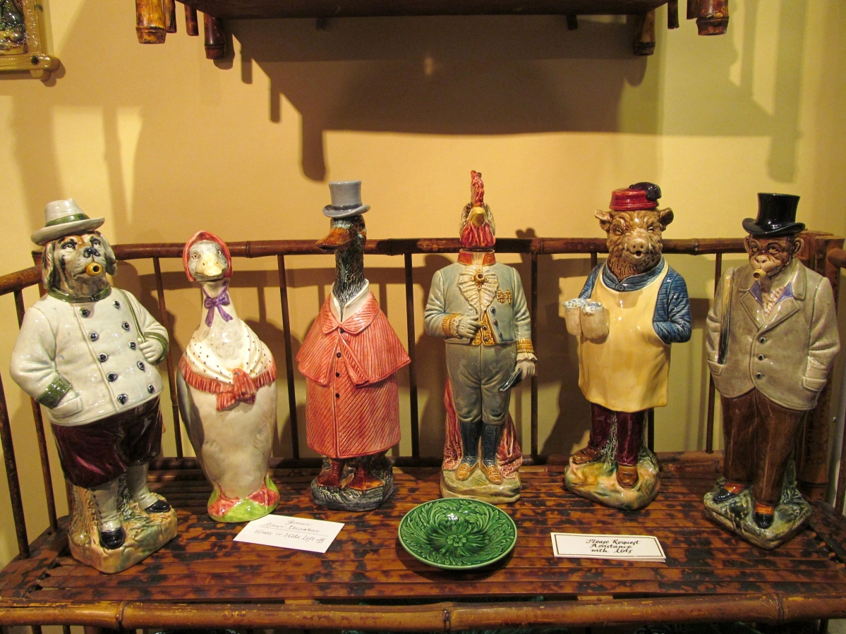 The German gentleman of the late Nineteenth Century might retire after dinner to smoke and sip a liquor poured from a whimsical Majolica decanter like these. Linda Ketterling Fine Majolica, Toledo, Ohio.