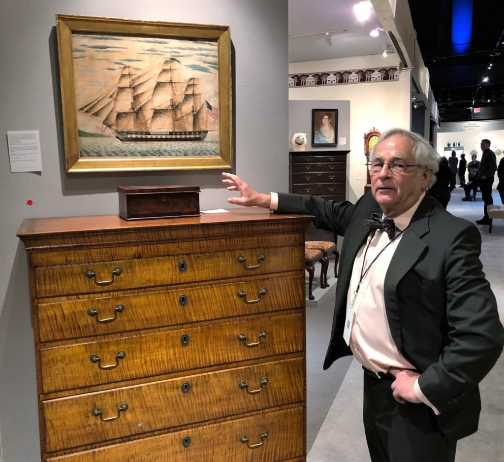 Connecticut dealer Arthur Liverant sold his tall chest of drawers in figured maple. The unsigned circa 1804-17 watercolor above it depicts the USS frigate President, a warship designed by Joshua Humphries in 1794 and built at the Christian Bergh Shipyard on the East River in New York City in 1800.