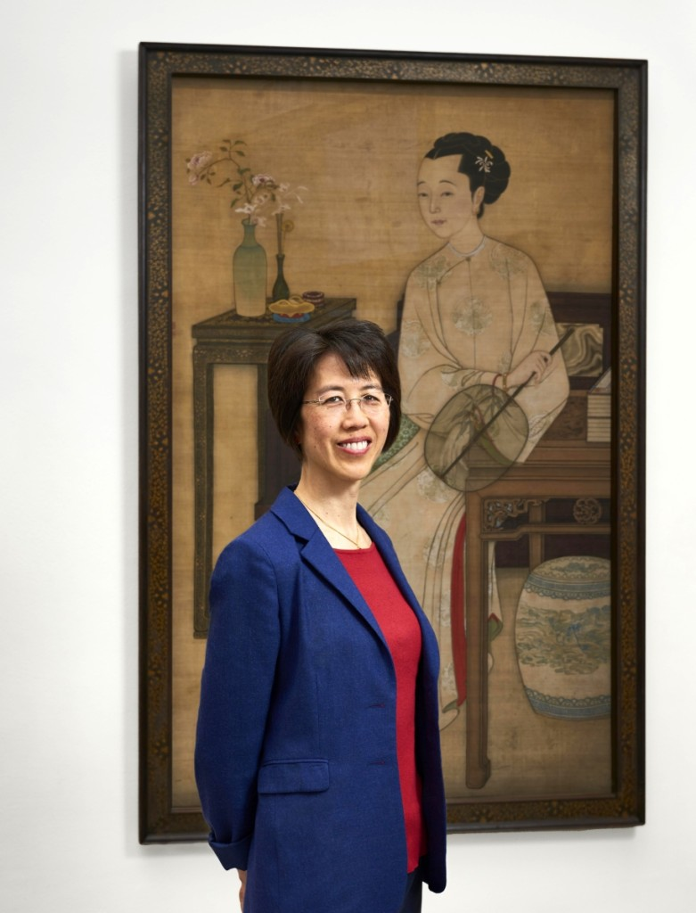 "Hiromi Kinoshita, the Hannah L. and J. Welles Henderson associate curator of Chinese art, stands in front of ""Portrait of a Manchu Lady,"" by Mangguri, early Eighteenth Century. Image courtesy of Philadelphia Museum of Art.   —Timothy Tiebout photo"