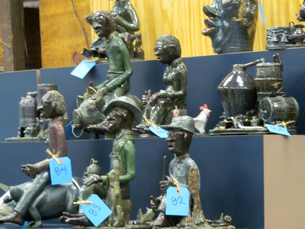 A group of Lin Craven sculpture forms. This group represented a moonshine still and various black folks at some task.