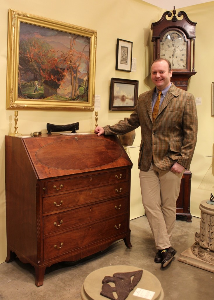 Taylor Thistlethwaite sold an early Baltimore chair on opening night and a Civil War sword during the show. He is shown here with a Federal inlaid walnut slant-lid desk from western Maryland that he found in Kentucky. Hanging above the desk is a western Maryland painting done by Gladys Nelson Smith. Thistlethwaite Americana, Alexandria, Va. and Glasgow, Ky.