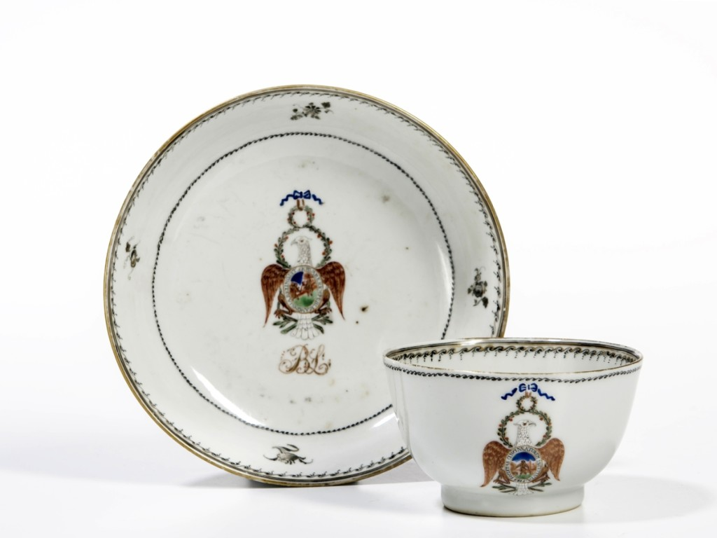 """One of the rarest of the rare. This Chinese export porcelain teacup and bowl bearing the Arms of the Society of Cincinnati and the initials """"BL"""" under the Arms sold for $92,250. """"BL"""" indicated that it was made for General Benjamin Lincoln and was part of a 45-piece tea service. The buyer said it was the only piece remaining in private hands."""