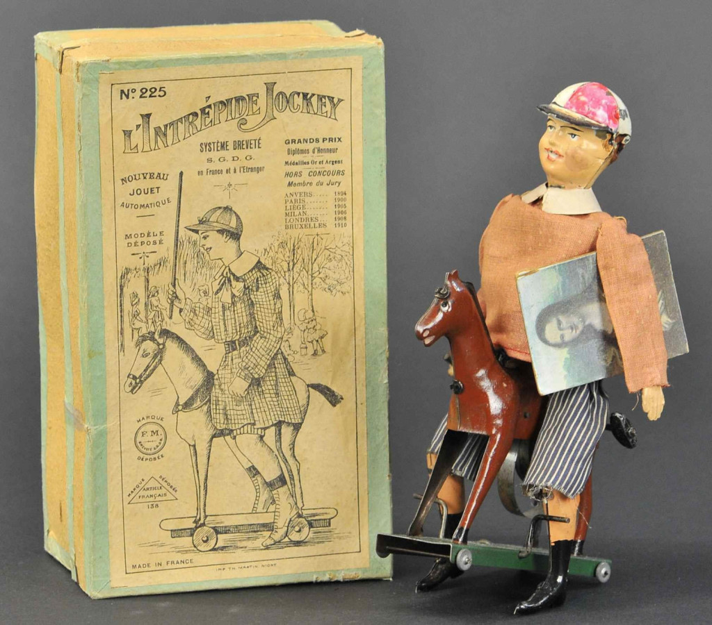 "The top Fernand Martin lot was this boxed example of L'Intrepide Jockey, which sold for $12,000. It was in pristine condition. The model offers a bit of humor on the 1911 theft of the ""Mona Lisa"" from the Louvre. Frank Mohr collection."