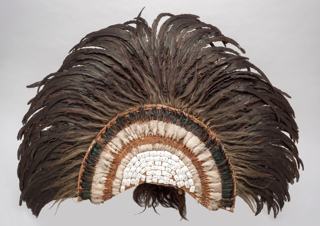 Feather headdress, Austral Islands, Eighteenth Century; feathers, shell, barkcloth, human hair, coconut fiber cord, vegetable fiber (various); 43-5/16 high by 43-5/16 wide by 8¼ inches deep. Peabody Museum of Archaeology and Ethnology, Harvard University Gift of the Heirs of David Kimball, 1899.