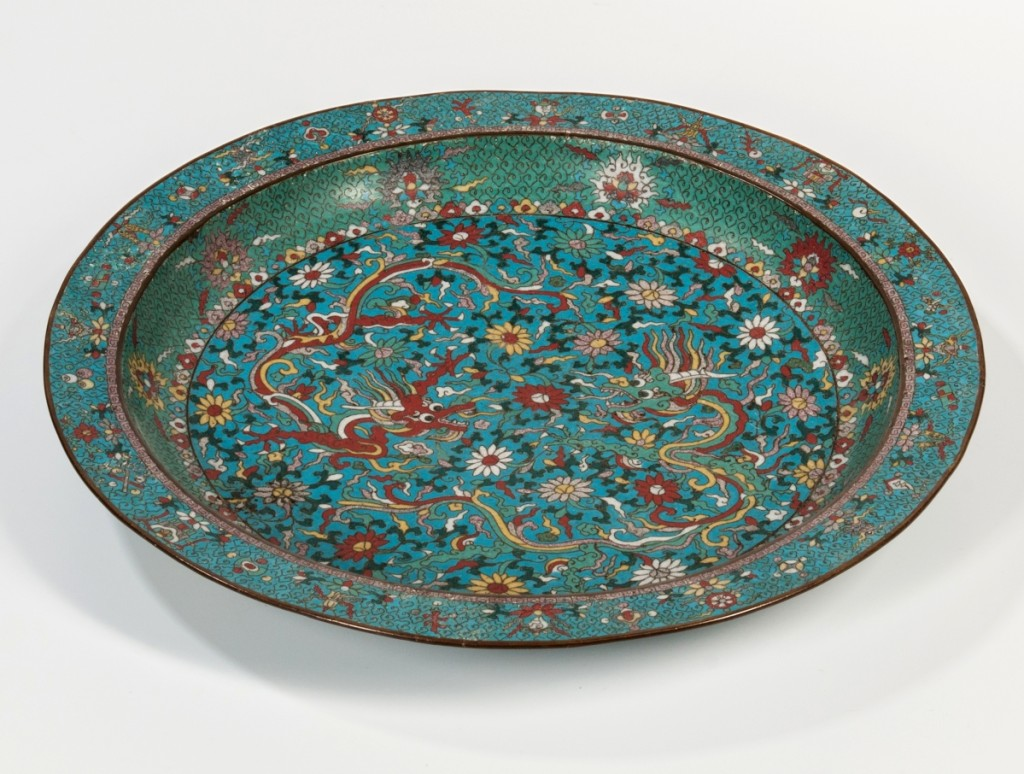 Leading the sale was this large cloisonne charger with dragons, China, early Twentieth Century, Ming dynasty style. It realized $315,000.