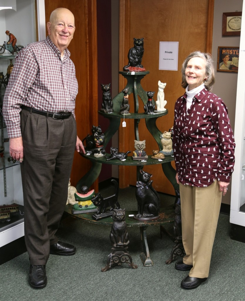 Elliotte and Liz Harold, whose single owner collection represented 691 lots of the sale's first day, stand with their collection of doorstops before the sale got underway.