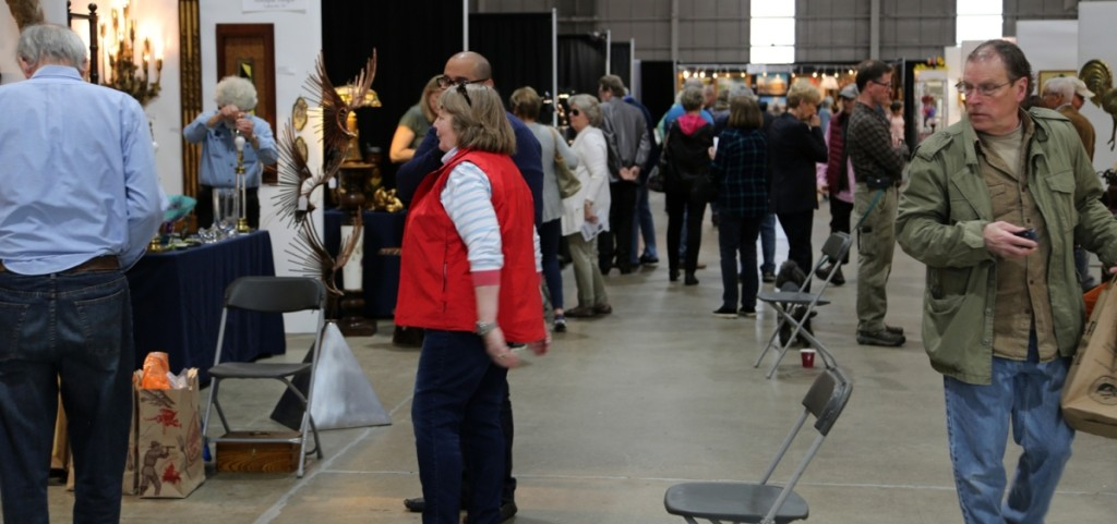 This is what commerce looks like. Buyers walk between booths shortly after the show opened on Saturday.