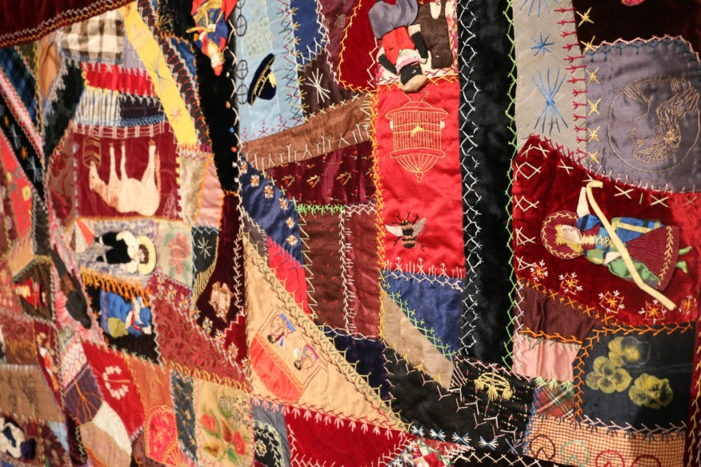 This Crazy Quilt of embroidered silks and velvets with three-dimensional dolls was made in 1883 by Amy Terrass Johnson Cowden (1861–1939) of Nashville in Davidson County.