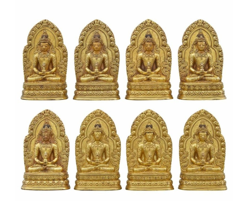 Set of eight Chinese gilt-bronze Bodhisattva, each 4¾ inches tall, brought $75,000 ($6/8,000).