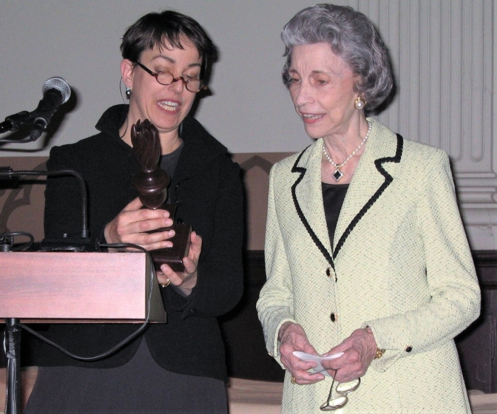 Philadelphia dealer Amy Finkel presents the 2005 Award of Merit trophy to Betty Ring.