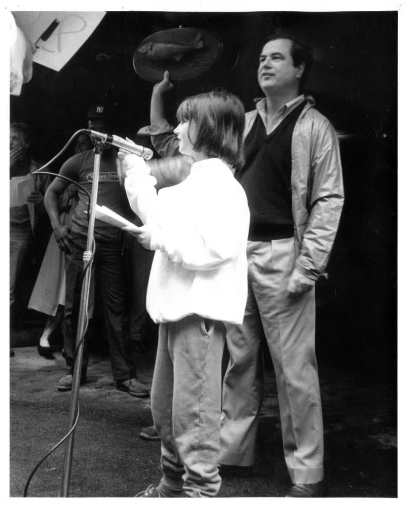 A young Laura Doyle tries her hand at auctioneering   with her father, William Doyle, behind.