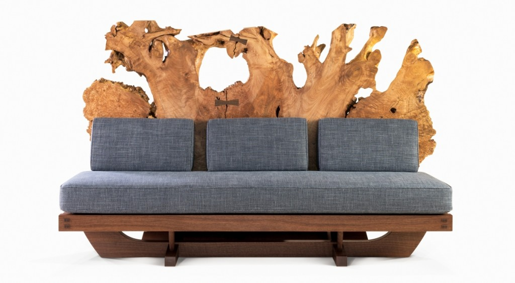 Mira Nakashima (b 1942), Tsuitate Sofa, designed in 2015, made in 2018. American black walnut, Oregon maple burl root, upholstery. Height 46 by width 75 by depth 37 inches. George Nakashima Woodworkers.