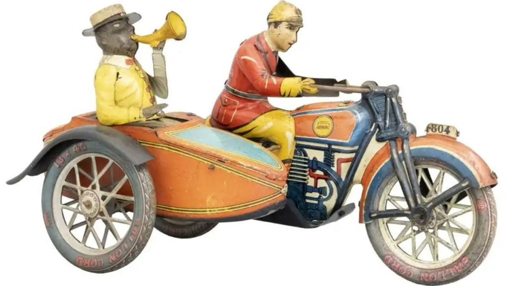 Based in Spain, the Paya Mfg. Co's tin motorcycle with side car is one of the scarcest tin toy motorcycles ever produced. It sold for $9,000.
