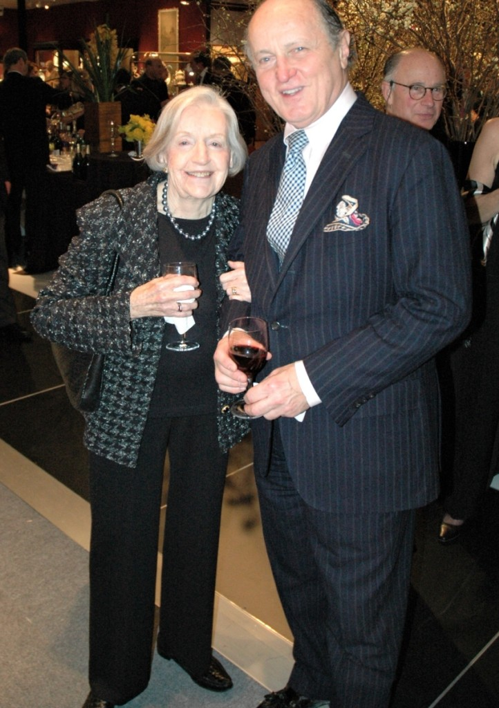 """Marguerite Riordan with Winter Antiques Show chairman Mario Buatta. """"Her booth was filled with folk art treasures that drew important collectors like a magnet,"""" says R. Scudder Smith. Riordan was a fixture of the show from 1972 until her retirement from it roughly 30 years later."""
