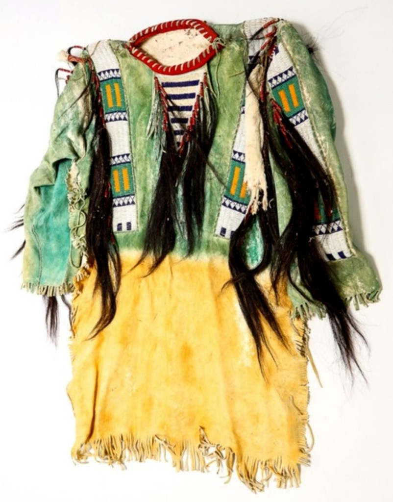 The Sioux beaded and dyed war shirt, with horsehair tassels attached, brought $9,300 and was the second highest price of the sale.