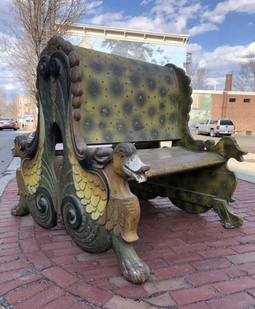 A Nineteenth Century double-sided carved carousel bench, carved with duck heads and other designs, realized $6,000. It had an original, untouched surface.