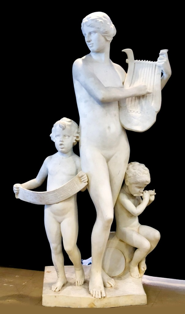 Art Deco sculpture by German-American artist Albert Weinert (1863–1947) included a young woman playing a lyre with two children at her side; dated 1924, the 78-by-40-inch signed sculpture realized $22,400.