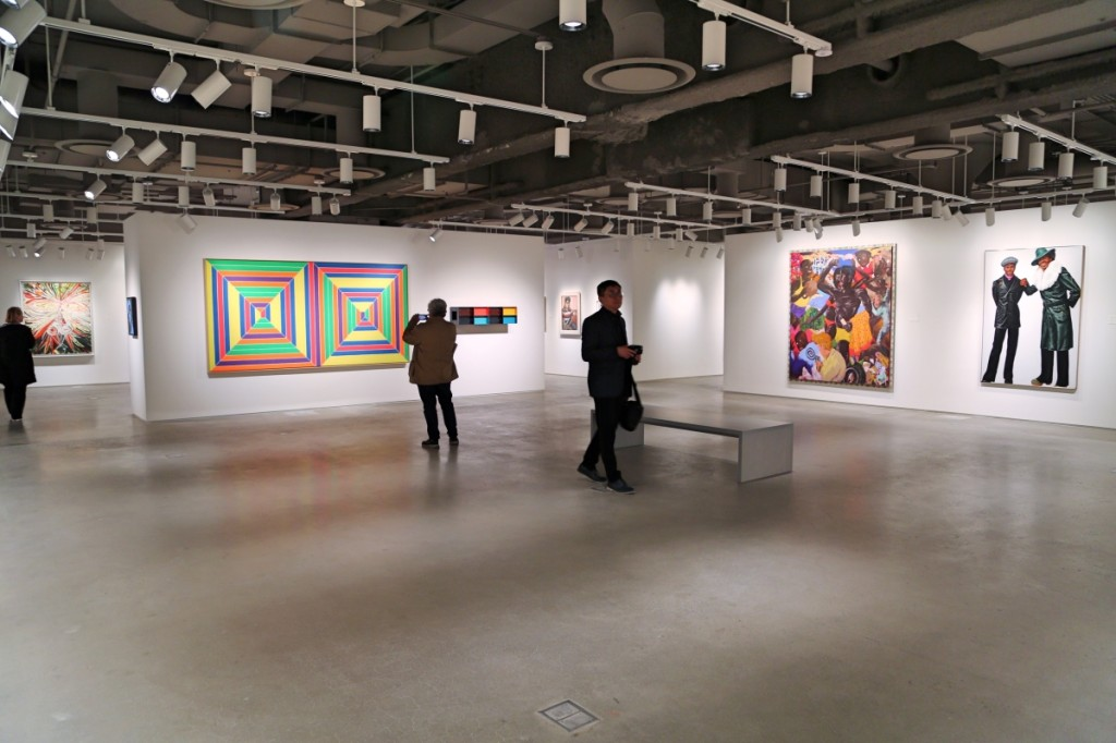 Visitors walk around Sotheby's newly unveiled galleries, which expand the firm's exhibition space from 67,000 to more than 90,000 square feet.