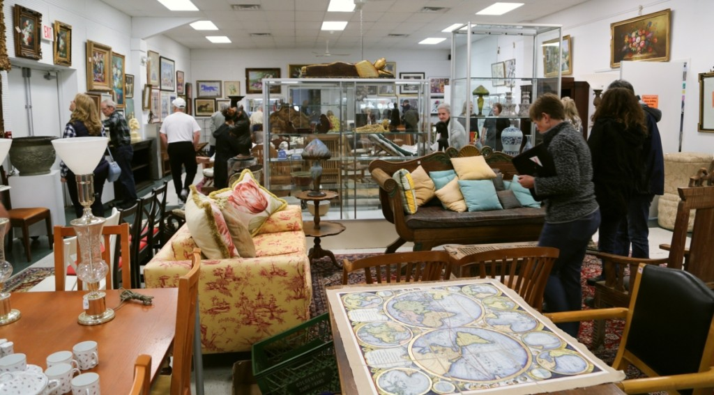 Prospective buyers peruse the last preview room at William J. Jenack Auctioneers.