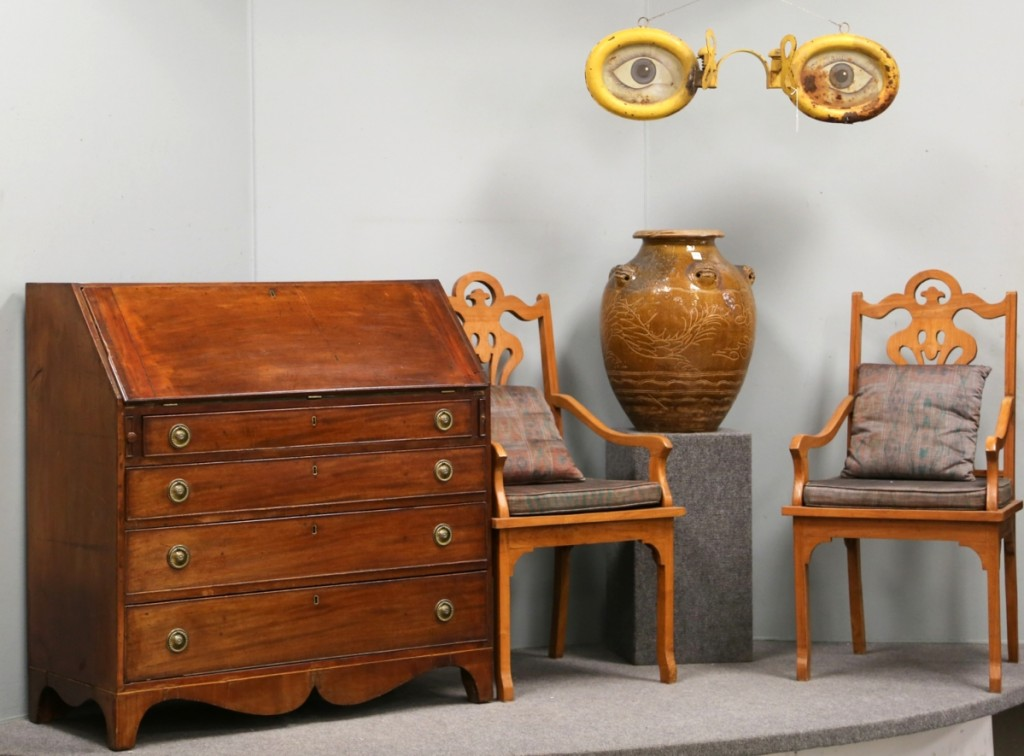 This vignette saw some ups and downs. The pair of chairs took $126, the Chinese handled jug brought $287, the Federal mahogany slant front desk went out at $150 and the optometrist trade sign sold for $805.