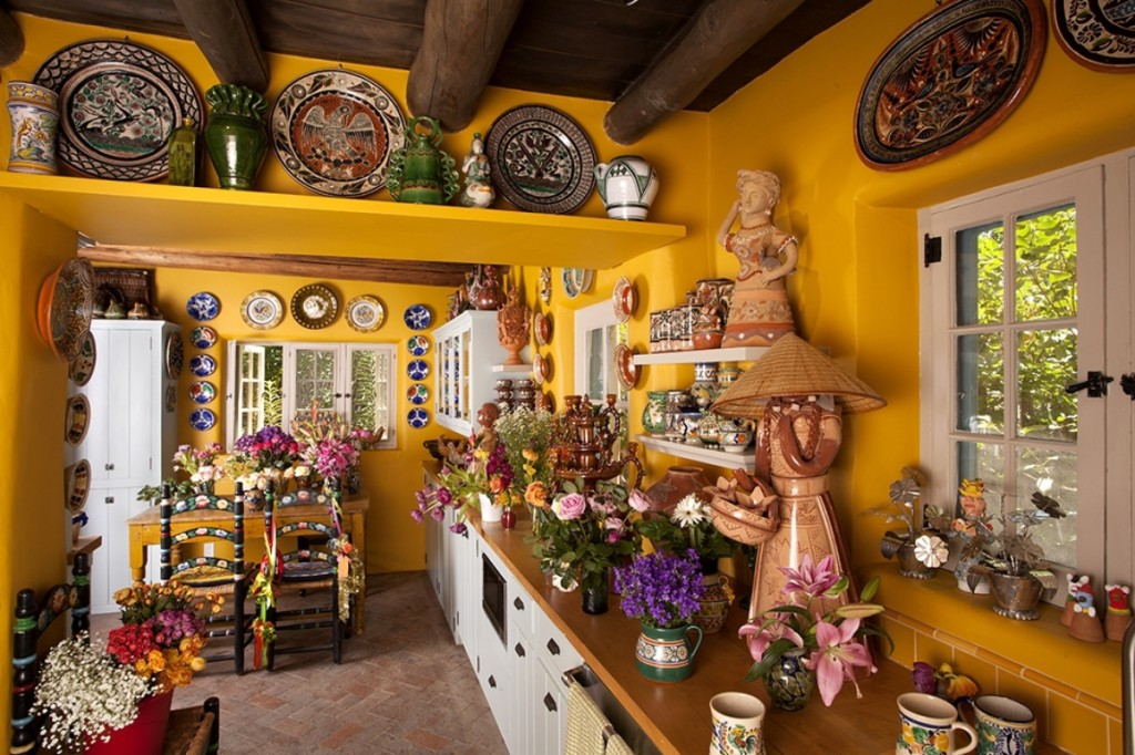 """As I collected, I began to imagine entire walls of plates. Today, I can't remember living in a home without a plate wall,"" says Espinar, whose kitchen, with plate borders, recalls the heyday of her popular Santa Fe store, The Clay Angel, now closed."