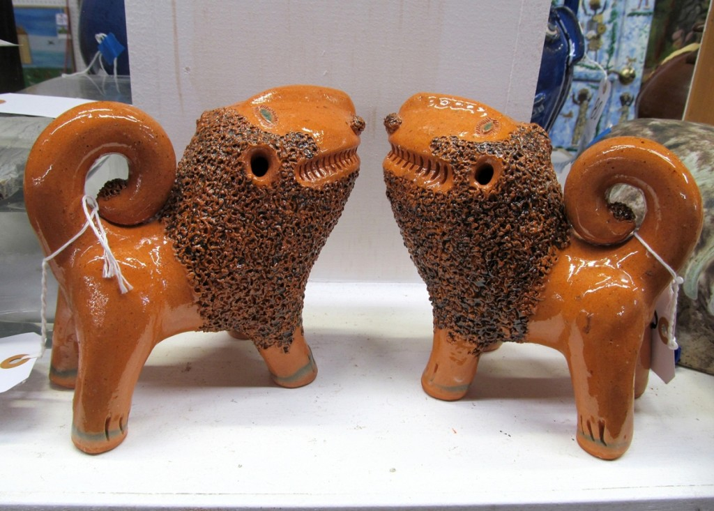 All eight Billy Ray Hussey pots sold well. This pair of the North Carolina potter's signature orange lions brought $1,200.