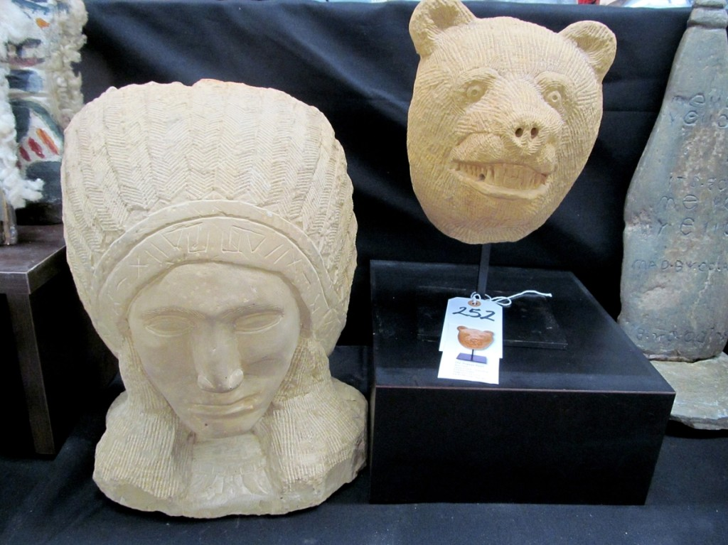 "Popeye Reed's carved stone ""Indian Chief with Headdress"" and ""Bear"" sold well at $1,320 and $1,800, respectively."