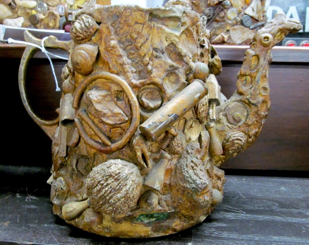 Memory items, usually jugs, are containers covered with all manner of small items such as keys, coins, seashells and even jewelry. A pair of encrusted teapots reminded one bidder of something so special that they bid $1,920, nearly four times the expected win.
