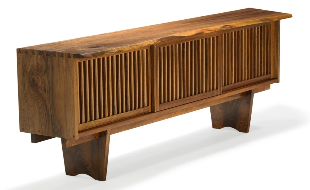 "The top selling lot from New Hope craftsman George Nakashima sold at $53,125. A triple sliding door cabinet, circa 1974, in Persian walnut and grass cloth. Following the sale, David Rago said, ""There's been a lot of Nakashima on the market so the prices aren't crazy but they are quite solid in almost all cases."""
